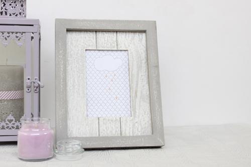 marco de fotos gris y blanco